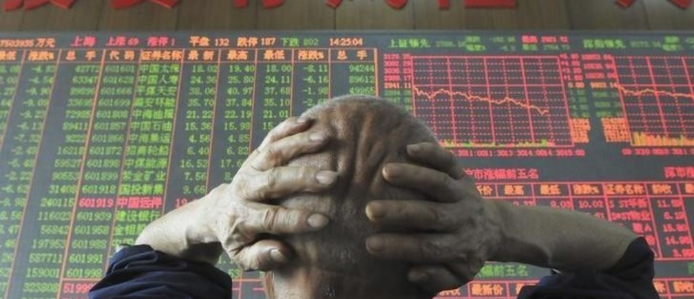 "An investor looks at an electronic board showing stock information at a brokerage house in Taiyuan, Shanxi province, June 19, 2008. China's main stock index tumbled 6.54 percent to a fresh 16-month closing low on Thursday after hoped-for government steps to support the market failed to materialise. The words on the wall reads: ""Investments have its risks"". REUTERS/China Daily (CHINA).  CHINA OUT. NO COMMERCIAL OR EDITORIAL SALES IN CHINA."