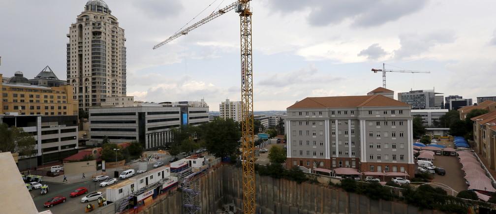 Construction is seen below the skyline of Johannesburg's upmarket Sandton suburb, February 5, 2016.