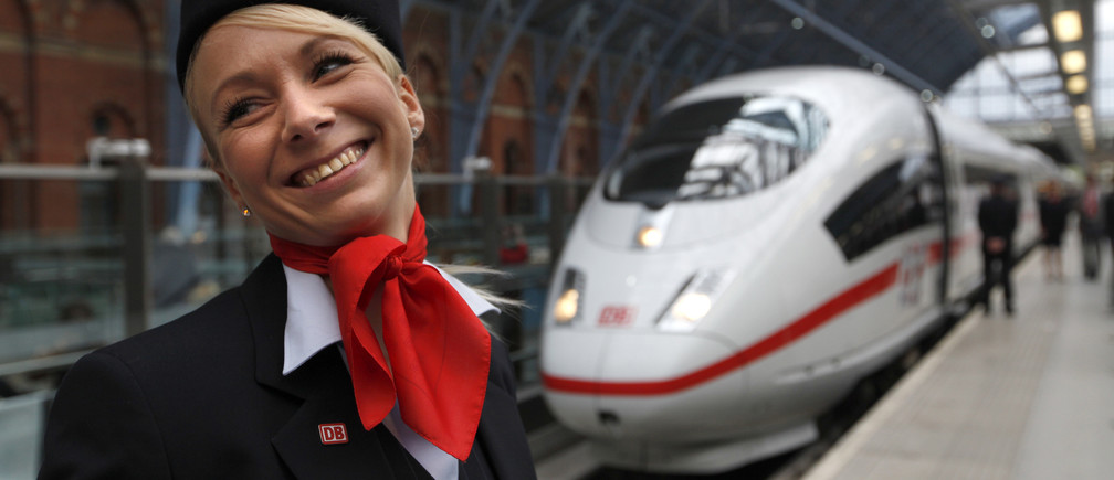 Medi Steigleder, who works on board the new ICE German high speed train, stands on the platform after it arrived at St Pancras station in London, October 19, 2010. Deutsche Bahn showcased a Siemens high-speed train in London on Tuesday which it hopes will run services to Germany through the Channel Tunnel, challenging Eurostar's monopoly and Alstom trains. The ICE 3 train, which can hit 320 kilometres per hour, was on display at London's St Pancras station following safety tests. Deutsche Bahn is aiming to operate services from London to Frankfurt and Cologne by the end of 2013. REUTERS/Andrew Winning (BRITAIN - Tags: BUSINESS POLITICS SOCIETY TRAVEL) - RTXTLO5