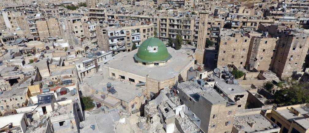 A general view taken with a drone shows damaged buildings and a mosque in the old city of Aleppo, Syria, October 13, 2016. Picture taken October 13, 2016. REUTERS/Abdalrhman Ismail - RTSS83I