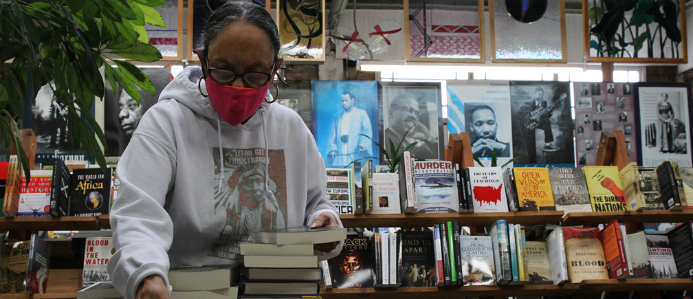 Blanche Richardson, who runs Marcus Books, an independent bookstore that has served the black community in the Bay Area with books by and about African Americans for the past 60 years, organizes books from a recent shipment, in Oakland, California, U.S. June 5, 2020. Picture taken June 5, 2020. REUTERS/Nathan Frandino - RC2R4H9JI90S