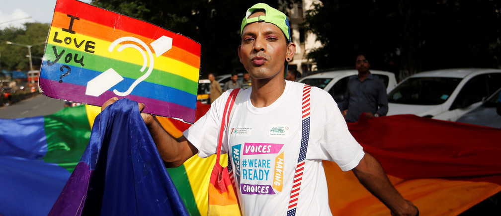 A supporter of the LGBT community in India celebrates the decriminalization of gay sex