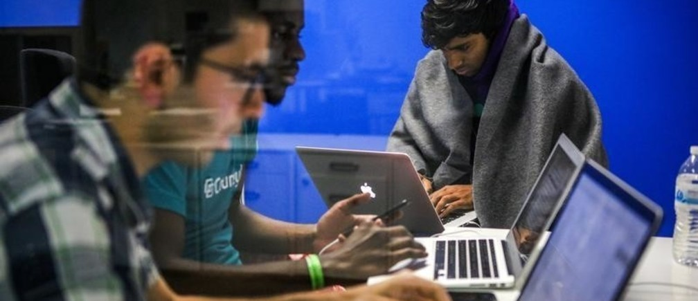 "Mehmet Efe Akengin, Hassan Kane and Surya Bhupatiraju (L-R) work late into the night on computers during a weekend Hackathon event, in San Francisco, California, U.S. July 17, 2016. REUTERS/Gabrielle Lurie SEARCH ""LURIE TECH"" FOR THIS STORY. SEARCH ""WIDER IMAGE"" FOR ALL STORIES. - RC1AF611F530"