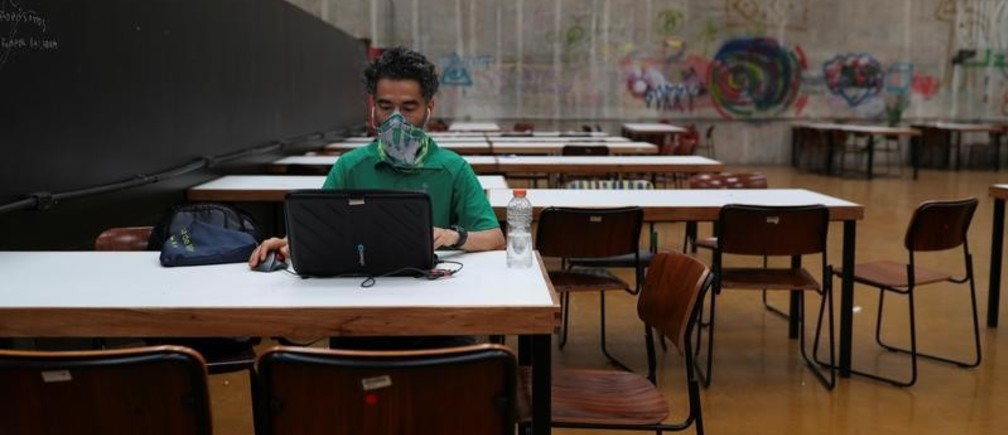 PhD student Sergio Antonio Perea Restrepo studies alone at University of Sao Paulo (USP) campus after classes were suspended due to coronavirus disease (COVID-19) outbreak in Sao Paulo, Brazil, March 17, 2020. REUTERS/Amanda Perobelli - RC2RLF9X984S