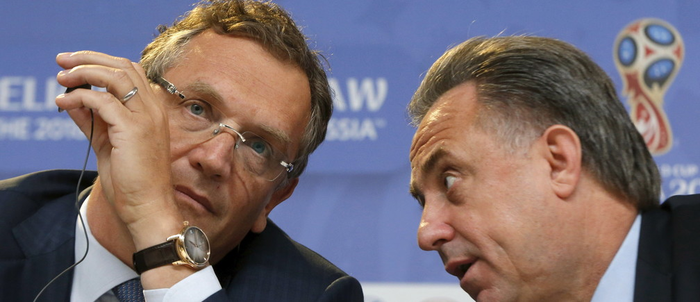 FIFA Secretary General Jerome Valcke (L) listens to Russian Sports Minister Vitaly Mutko during a news conference in St. Petersburg, Russia, July 24, 2015. Valcke all but confirmed on Friday that he will be leaving his job when Sepp Blatter is replaced as president of world soccer's governing body next February. REUTERS/Maxim Shemetov - RTX1LNQ1