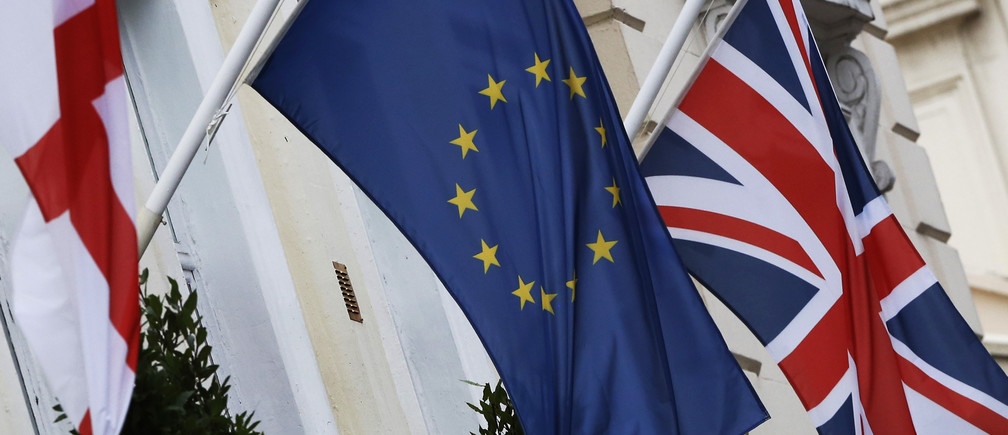 The St George's Cross, European Union and Union flags fly outside a hotel in London, Britain, December 17, 2015. European Union leaders could clinch a deal with British Prime Minister David Cameron in February to prevent the bloc's second largest economy leaving, European Council President Donald Tusk said on Thursday. Cameron is seeking to renegotiate Britain's relationship with the bloc it joined in 1973 ahead of a referendum on membership to be held by the end of 2017. Some EU leaders are wary of agreeing to all of his demands, however, particularly on cutting benefits for EU migrants to Britain.