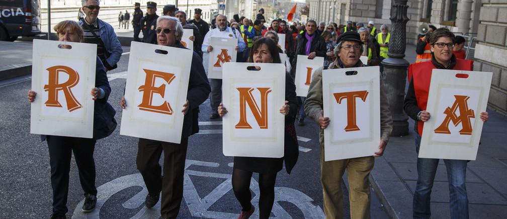 Spanish demonstrators demanding universal basic income.