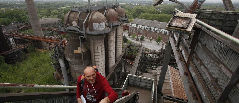 A man walks up stairs of a shut-down blast furnace which has been turned into a museum in the western German city of Duisburg May 31, 2012. REUTERS/Wolfgang Rattay