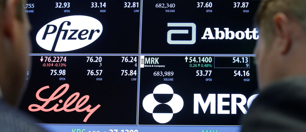 A screen displays trading information for stocks; Pfizer, Abbott Laboratories, Merck and Company and Eli Lilly and Company on the floor of the New York Stock Exchange (NYSE) in New York City, U.S., May 16, 2016.  REUTERS/Brendan McDermid/File Photo - RTSVG7C