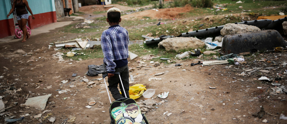 A boy pulls his school bag at a favela, or a slum, in Rio de Janeiro, Brazil June 24, 2016. Picture taken June 24, 2016. REUTERS/Nacho Doce - RTSVS5W