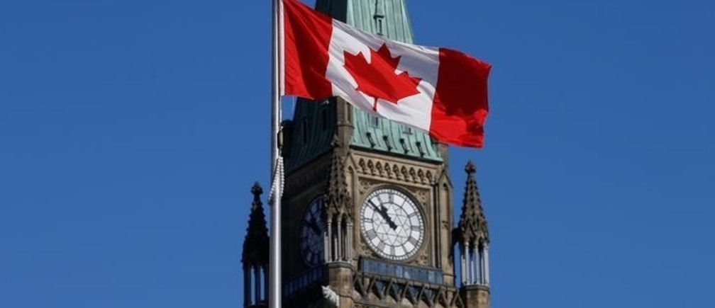 A Canadian flag flies in front of the Peace Tower on Parliament Hill in Ottawa, Ontario, Canada, March 22, 2017. REUTERS/Chris Wattie