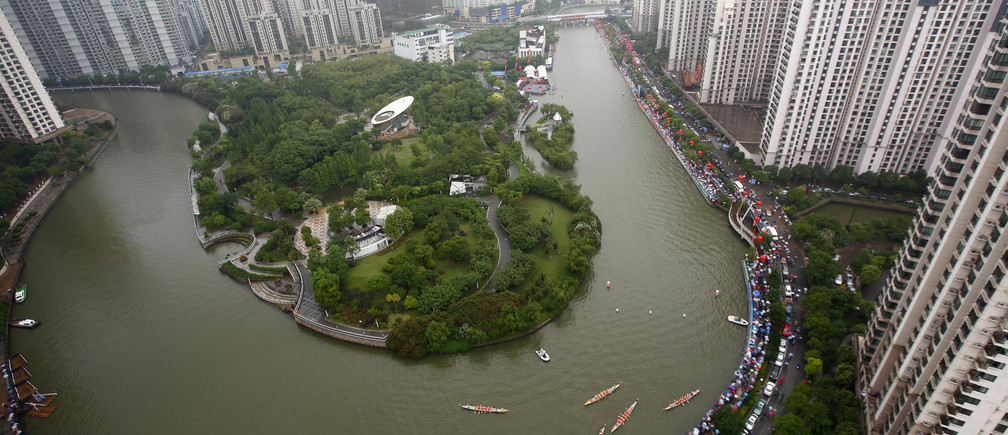 An aerial view shows boats participating in a dragon boat race to celebrate the Dragon Boat Festival, also known as Duanwu Festival, on the Suzhou river in Shanghai June 6, 2011.