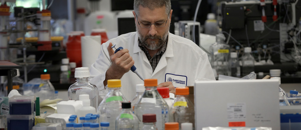 Research scientist Dan Galperin works on Purified Recombinant Zika Enveloped Protein in his laboratory where they are working on developing a vaccine for the Zika virus based on production of recombinant variations of the E protein from the Zika virus at the Protein Sciences Inc. headquarters in Meriden, Connecticut, U.S., June 20, 2016. Picture taken June 20, 2016. REUTERS/Mike Segar - S1BEUEYZHBAB