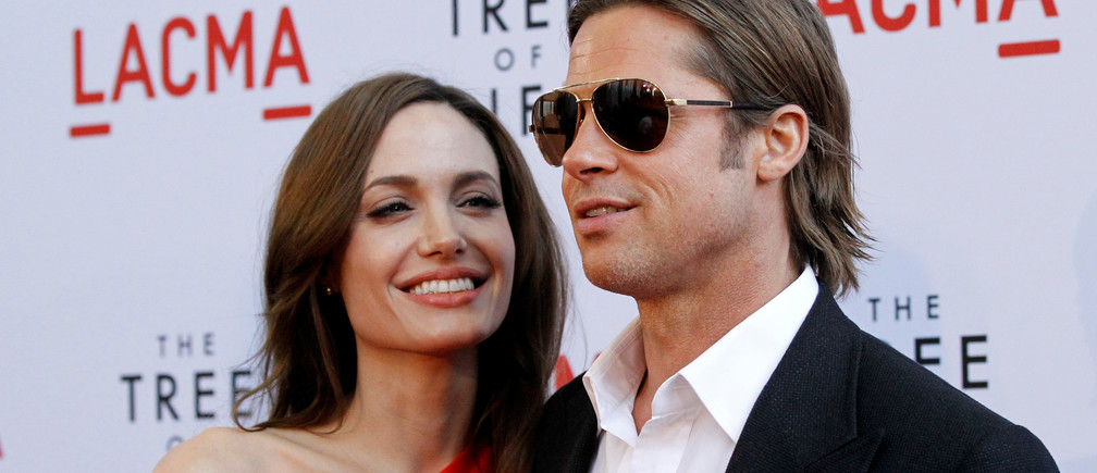 "Cast member Brad Pitt and actress Angelina Jolie pose at the premiere of ""The Tree of Life"" at LACMA in Los Angeles May 24, 2011. REUTERS/Mario Anzuoni/File Photo - S1BEUCKILLAB"