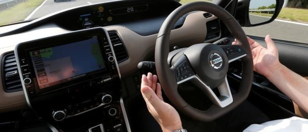 A Nissan employee removes his hands from the steering wheel as he test drives Nissan's new Serena minivan which is equipped with Propilot semi-automated driving functions, at the company's test drive facility in Yokosuka, Japan July 12, 2016. Picture taken July 12, 2016. REUTERS/Toru Hanai