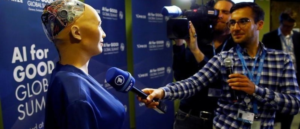 "A TV crew interviews Sophia, a robot integrating the latest technologies and artificial intelligence created by Hanson Robotics, during a presentation at the ""AI for Good"" Global Summit at the International Telecommunication Union (ITU) in Geneva, Switzerland June 7, 2017. REUTERS/Denis Balibouse - RC167AA4E9D0"