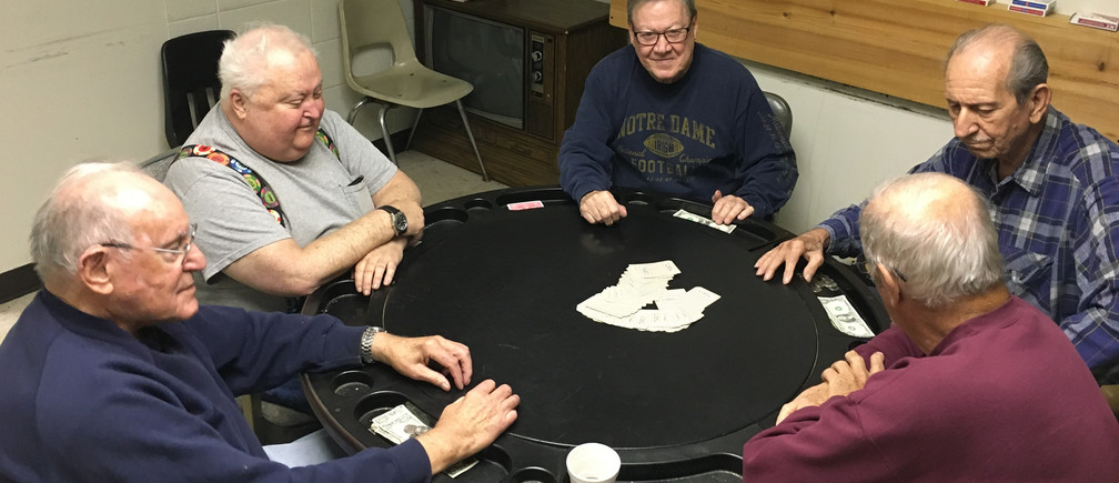 Retired steel workers Mike Pron (L to R) Jim McAndrew, Charlie Kelly, Joe Gonda and Ken Rayden play poker in a union hall in Bethlehem Pennsylvania, U.S., November 9, 2016. Among the five retirees, all life-long Democrats, only three cast ballots for Clinton in a county which voted Democratic in the past two election cycles but backed Republican Donald Trump in this year's presidential race.    REUTERS/Peter Eisler - RTX2T3BL