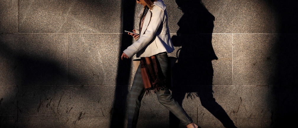 """A woman looks at her mobile phone early morning in Westminster, London, Britain October 10, 2016. REUTERS/Stefan Wermuth SEARCH """"WERMUTH PHONES"""" FOR THIS STORY. SEARCH """"THE WIDER IMAGE"""" FOR ALL STORIES. - RC184A3646A0"""