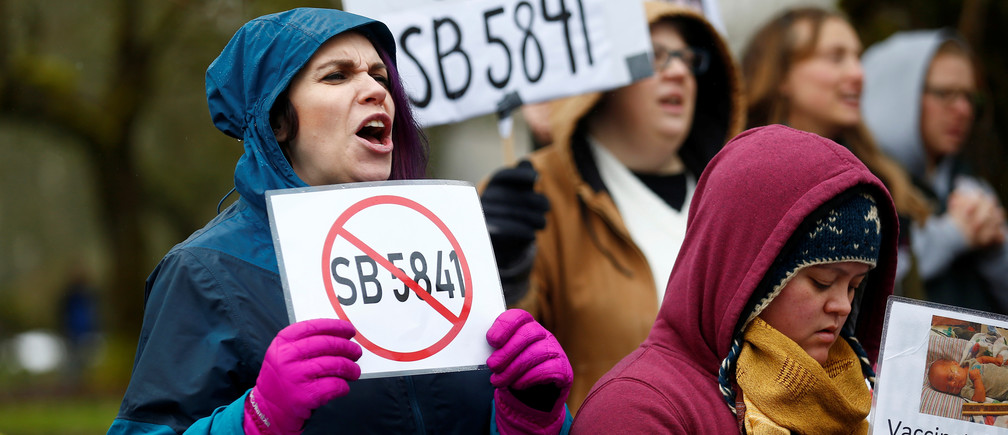 "Krystal Glass of Vancouver, Washington, holds up an anti-SB 5841 sign during the ""March for Medical Freedom"" against mandatory vaccinations before the SB 5841 hearing in Olympia, Washington, U.S., February 20, 2019.  REUTERS/Lindsey Wasson - RC1AEC610BB0"