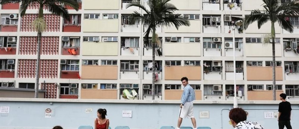 People take photo in front of Choi Hung estate, an apartment complex that became famous because of the rainbow color paints in Hong Kong, China, June 23, 2019. REUTERS/Ann Wang     TPX IMAGES OF THE DAY - RC132CB9B710