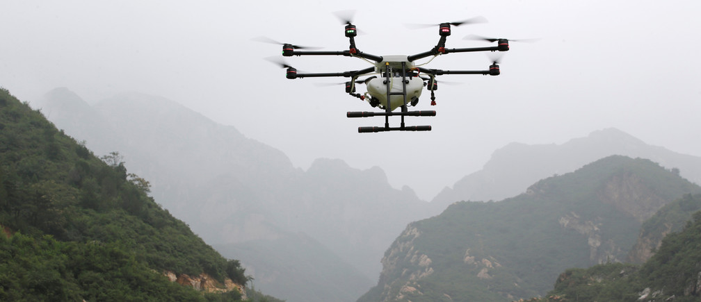 An aerosol drone flies during a training at LTFY drone training school on the outskirts of Beijing, China August 2, 2017. Picture taken August 2, 2017. REUTERS/Jason Lee - RC1B40E63D70