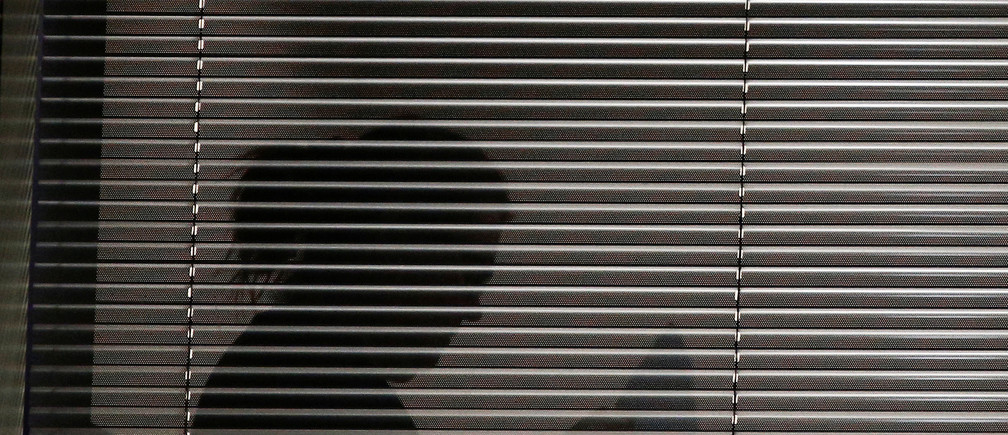 A person is seen inside the building which houses the offices of Cambridge Analytica as investigators from Britain's Information Commissioners Office entered, following the granting of a search warrant by a High Court judge, in London, Britain March 23, 2018. REUTERS/Henry Nicholls - RC14F4D71170