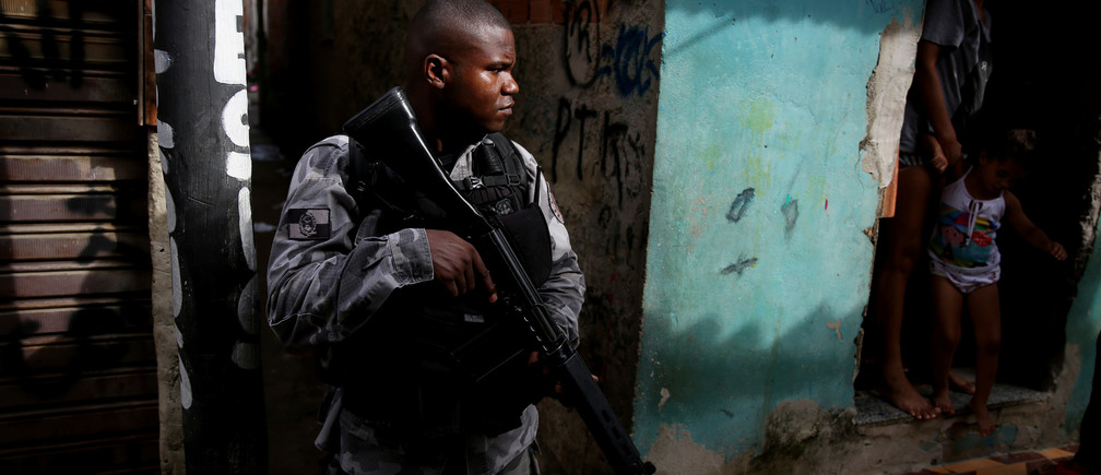 A military police officer patrols the Kelson's slum during a joint operation with the armed forces in Rio de Janeiro, Brazil.