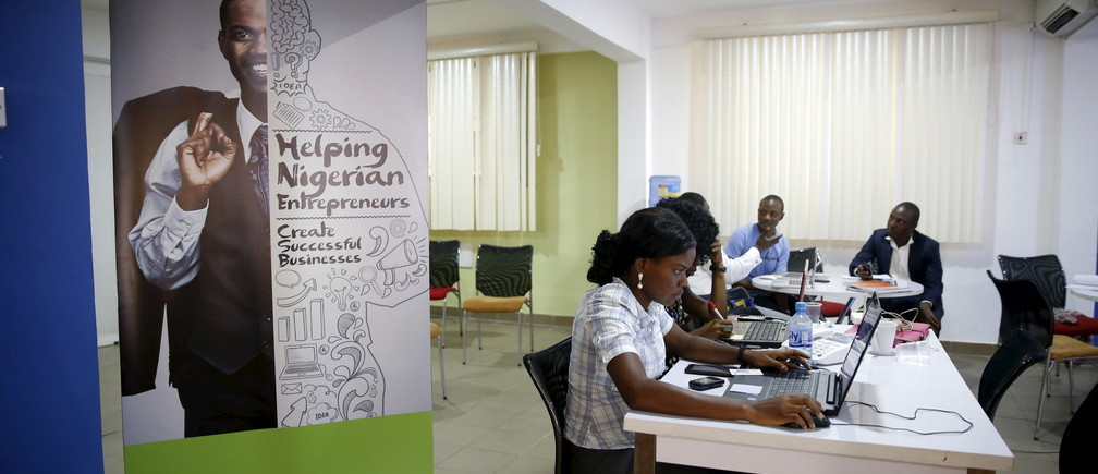 Software developers work on computer sytems at the Information Technology Developers Entrepreneurship Accelerator (iDEA) hub in the Yaba district in Lagos