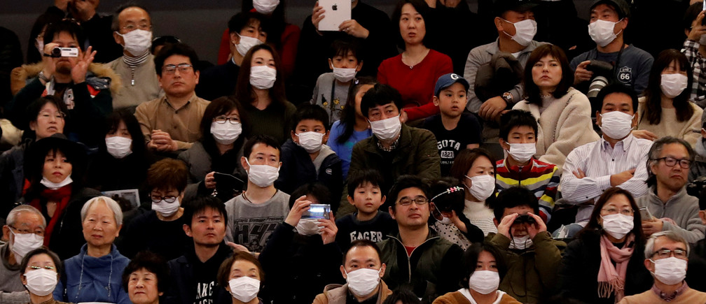 Visitors wearing surgical masks attend the opening ceremony of the Ariake Arena, which will host volleyball and wheelchair basketball competitions in Tokyo 2020 Olympic Games in Tokyo, Japan February 2, 2020. REUTERS/Kim Kyung-Hoon     TPX IMAGES OF THE DAY - RC25SE906L4U