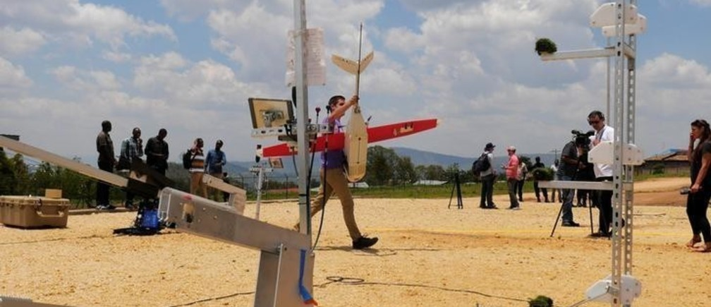 Zipline engineer carries a drone at the operation base in Muhanga, south of Rwanda's capital Kigali where Zipline, a California-based robotics company delivered their first blood to patients using a drone October 12, 2016. Picture taken October 12, 2016. REUTERS/James Akena