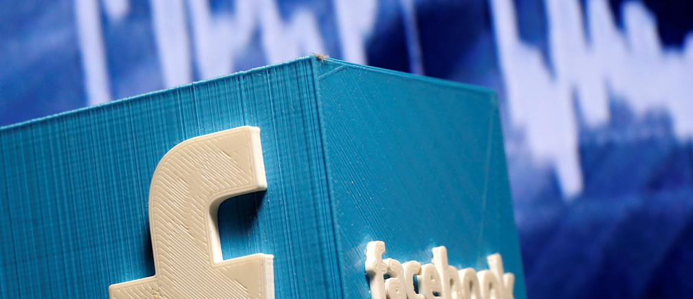 A 3D-printed Facebook logo is seen in front of a displayed stock graph in this illustration taken November 3, 2016.  REUTERS/Dado Ruvic/Illustration - RTX2RSM3