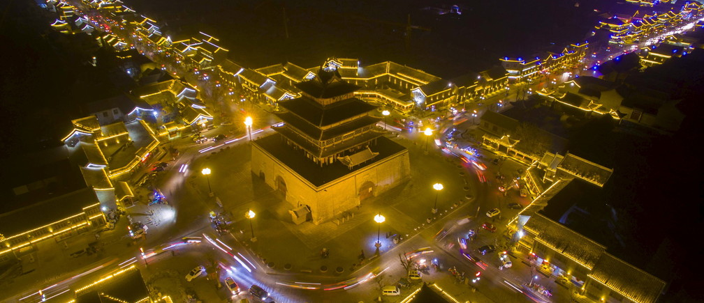 Traditional buildings of a tourist spot are seen lit up at night in Liaocheng, Shandong province, February 10, 2016.