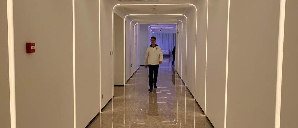 A staff member walks in the hallway during a demonstration to the media at Alibaba Group's futuristic FlyZoo hotel in Hangzhou, Zhejiang province, China January 22, 2019. REUTERS/Xihao Jiang