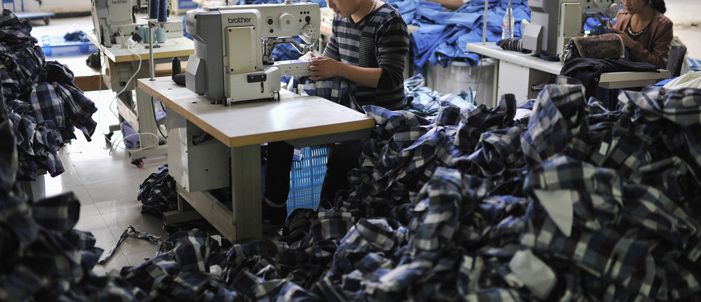 Workers manufacturing clothes for export, in Wuhu, Anhui province, China.