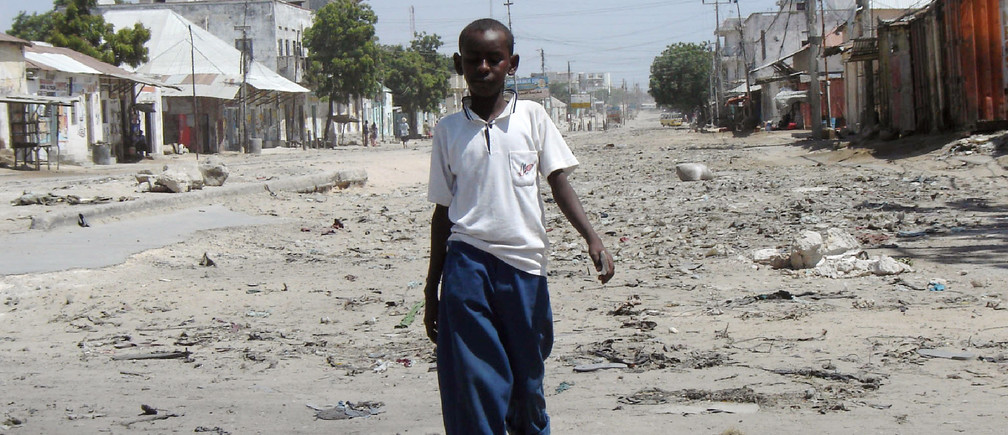 Somali boy walks along a deserted street that was once one of the busiest in the Somali capital Mogadishu, January 10, 2008.