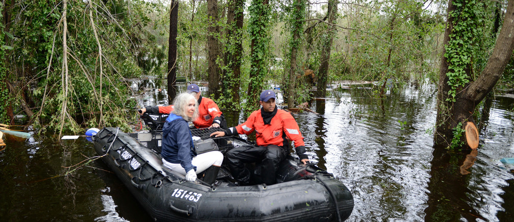 An elderly woman and her husband along with their pets are rescued by U.S. Coast Guard after their home was flooded by Hurricane Florence, in Brunswick County, North Carolina, U.S., September 16, 2018. Picture taken September 16, 2018.   Courtesy Trevor Lilburn/U.S. Coast Guard District 5/Handout via REUTERS  ATTENTION EDITORS - THIS IMAGE HAS BEEN SUPPLIED BY A THIRD PARTY.  MANDATORY CREDIT. - RC1BBF6FBC80