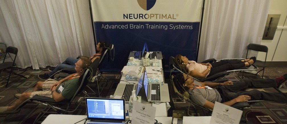 Attendees take part in a neuro-feedback session during the opening day of the second annual Bulletproof Biohacking Conference at the Pasadena Convention Center in California September 26, 2014.