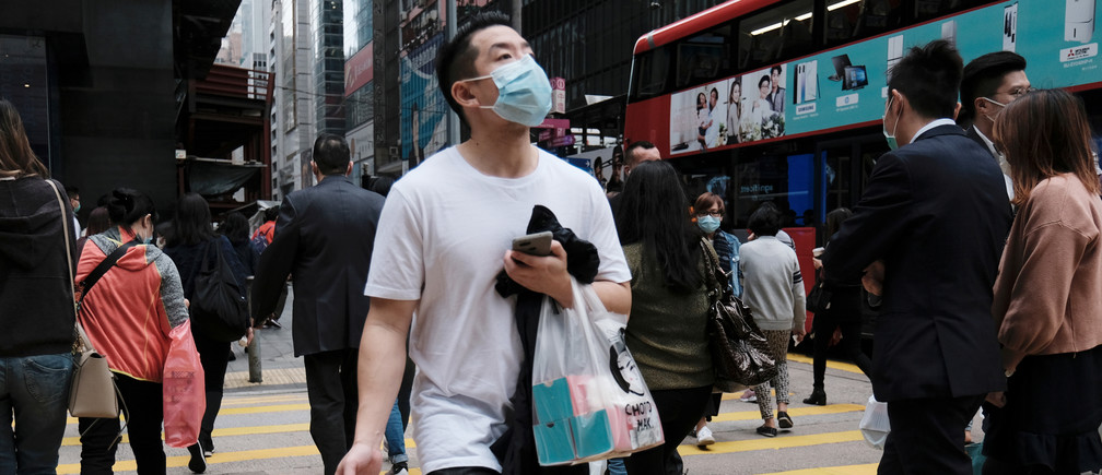 People wear protective face masks as they take their lunch breaks at the financial Central district, following the outbreak of the new coronavirus, in Hong Kong women business businesswoman businessman corporation corporate finance wall street stock exchange capitalism private ownership board c-suite CEOs CFOs corporation united states us america wall street change gender parity equality goldman sachs davos industry representation fair finance fiscal financial economics economies trading trade price money profit value men male female change changing 2020 future taxation tax wealth gross domestic product gdp Coronavirus china virus health healthcare who world health organization disease deaths pandemic epidemic worries concerns Health virus contagious contagion viruses diseases disease lab laboratory doctor health dr nurse medical medicine drugs vaccines vaccinations inoculations technology testing test medicinal biotechnology biotech biology chemistry physics microscope research influenza flu cold common cold bug risk symptomes respiratory china iran italy europe asia america south america north washing hands wash hands coughs sneezes spread spreading precaution precautions health warning covid 19 cov SARS 2019ncov wuhan sarscow wuhan pneumonia  pneumonia outbreak patients unhealthy fatality mortality elderly old elder age serious death deathly deadly