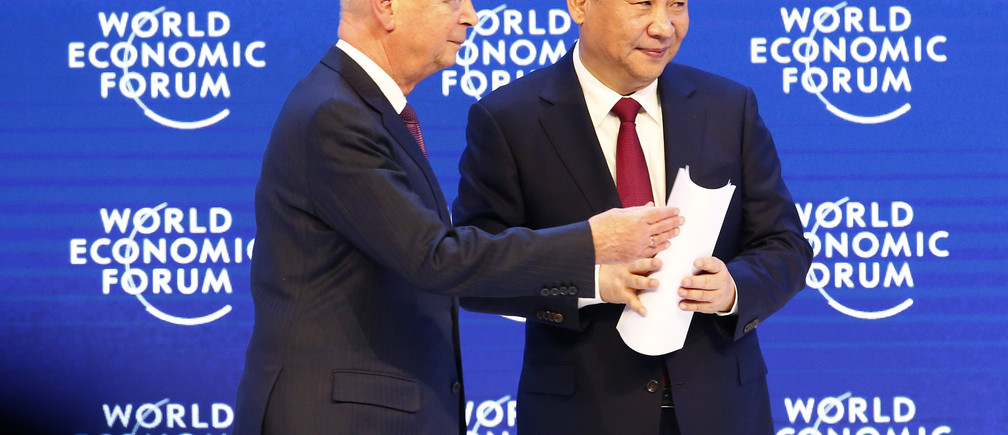 Klaus Schwab, Founder and Executive Chairman of the WEF (L) walks out with Chinese President Xi Jinping after a session during the World Economic Forum (WEF) annual meeting in Davos, Switzerland January 17, 2017.  REUTERS/Ruben Sprich - RTSVVF6