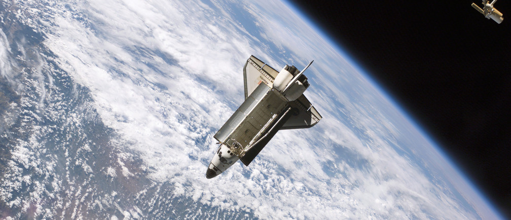 The Space Shuttle Atlantis (STS-115) undocks from the International Space Station in this NASA handout photo dated September 17, 2006. REUTERS/NASA/Handout  (UNITED STATES - Tags: SCI TECH) FOR EDITORIAL USE ONLY. NOT FOR SALE FOR MARKETING OR ADVERTISING CAMPAIGNS. THIS IMAGE HAS BEEN SUPPLIED BY A THIRD PARTY. IT IS DISTRIBUTED, EXACTLY AS RECEIVED BY REUTERS, AS A SERVICE TO CLIENTS - GM1E76K1AOJ01