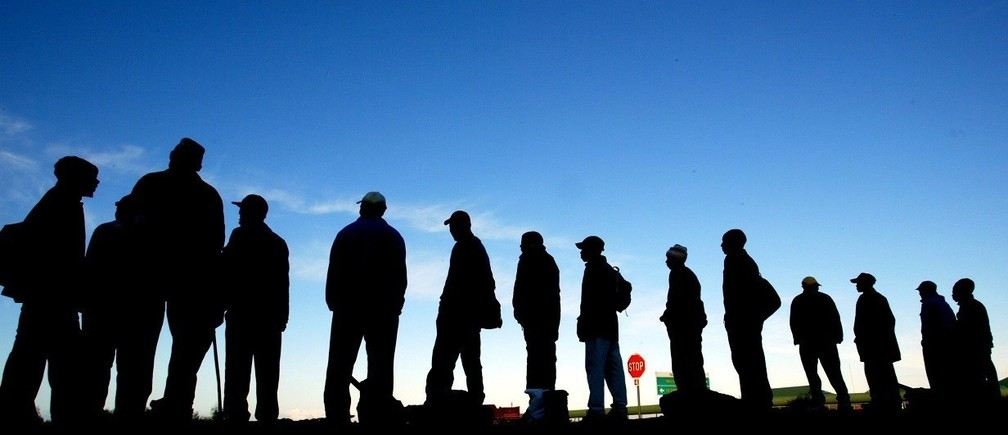 Job seekers wait for employers seeking casual labour on the streets of CapeTown, June 13, 2003. Each day thousands of unemployed men wait at the sitesscattered across the city in the hope of gaining casual work in theconstruction and farming industries. Employers in passing trucks offer thechance of work and a R60 ($8) payday for some, but for others it is a longfutile wait. With unemployment estimated as high as 40 percent, job creationhas been identified as a priority for the South African economy.-PICTURETAKEN JUNE 13 2003 FOR RELEASE WITH STORY BC SAFRICA JOBLESS NO RIGHTS CLEARANCES OR PERMISSIONS ARE REQUIRED FOR THIS IMAGEREUTERS/Mike Hutchings    PP03090004MH/WS - RTR2CXX