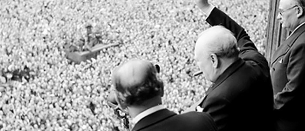 Churchill waves to crowds in Whitehall on the day he broadcast to the nation that the war with Germany had been won, 8 May 1945
