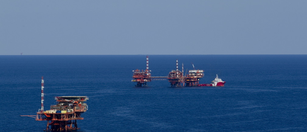 """An oil platform is seen in the Adriatic Sea, Croatia, May 28, 2015. When Croatia announced in 2013 it would set a tender to explore for oil and gas in its pristine Adriatic waters, the government evoked the hydrocarbon riches of Norway to win over the plan's many detractors. Prime Minister Zoran Milanovic in April, defended an effort he hopes could help turn around Croatia's economic fortunes after six years of recession. He was responding to public concerns that the project is a high-risk gamble that may forever change the way of life on Croatia's more than 1,000 islands, hurt its lucrative tourism industry and harm the environment. But with contracts expected to be signed with five selected concessionaires by July, opposition from local and international environmentalists, politicians and even pop stars -- expressed in the campaign """"SOS for Adriatic"""" -- is only growing. Picture taken May 28, 2015. REUTERS/Antonio Bronic - GF10000113867"""