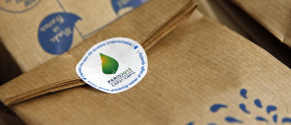 A sticker with the logo of the upcoming COP21 Climate Change Conference is seen on the packaging of Gobi reusable bottle without Bisphenol-A at the Gobilab headquarters in Paris, France, November 16, 2015. French start-up Gobilab will provide 36,000 bottles to 2015 Paris climate conference. REUTERS/Benoit Tessier - PM1EBBG1AR001