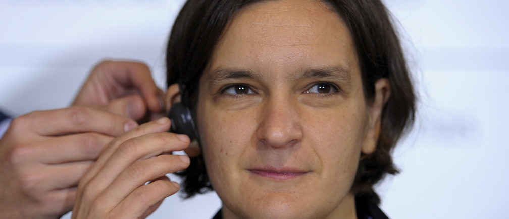 French economist Esther Duflo gets fitted with an earphone before a news conference in Oviedo, October 22, 2015. Duflo will be awarded the 2015 Princess of Asturias Award for Social Sciences at a ceremony on Friday in the Asturian capital. The awards are held annually since 1981 to reward scientific, technical, cultural, social and humanitarian work done by individuals, work teams and institutions.