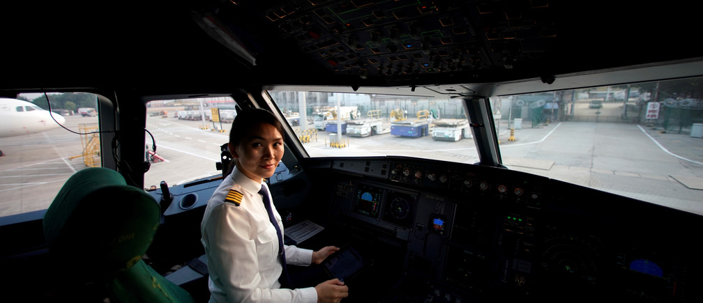 Captain Han Siyuan, 30, poses in the cockpit of Spring Airlines' Airbus A320 before taking off at Hongqiao International Airport in Shanghai, China October 18, 2018. Picture taken October 18, 2018. REUTERS/Aly Song - RC1A3D802E00
