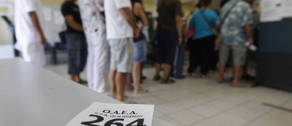 A priority ticket is seen as people line up inside an unemployment bureau in Athens September 6, 2012. Greece's jobless rate scaled a new record high of 24.4 percent in June from an upwardly revised 23.5 percent in May, the country's statistics service ELSTAT said on Thursday, as a deep, austerity-fuelled recession continued to take a toll on the labour market.  REUTERS/John Kolesidis  (GREECE - Tags: BUSINESS EMPLOYMENT) - RTR37K4M