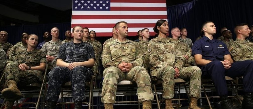Members of the U.S. military listen as U.S. President Donald Trump announces his strategy for the war in Afghanistan during an address to the nation from Fort Myer, Virginia, U.S., August 21, 2017. REUTERS/Joshua Roberts - UP1ED8M04P4EC