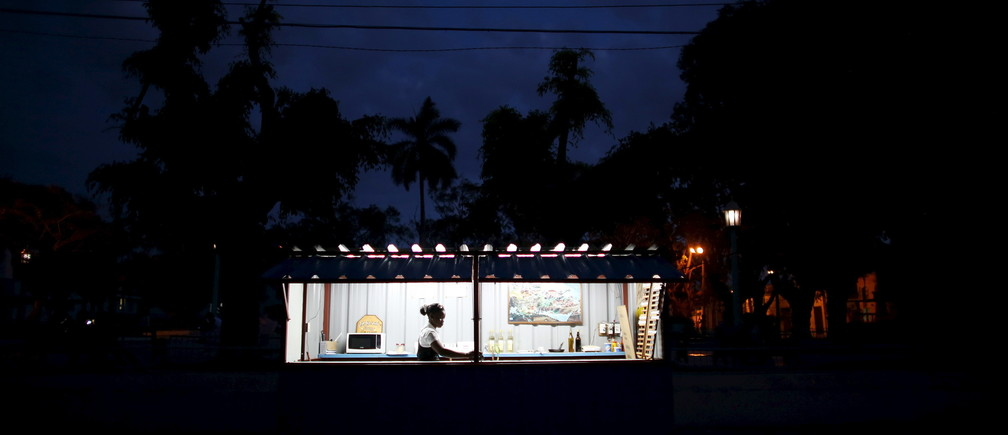 Neilae Bignotle, 23, waits for customers in a small snack shop in Regla, Cuba, March 17, 2016. REUTERS/Alexandre Meneghini  - GF10000349820