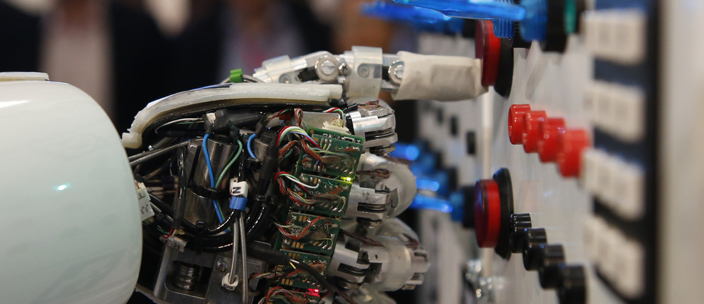 The hand of humanoid robot AILA (artificial intelligence lightweight android) operates a switchboard during a demonstration by the German research centre for artificial intelligence at the CeBit computer fair in Hanover March, 5, 2013. The biggest fair of its kind open its doors to the public on March 5 and will run till March 9, 2013.  REUTERS/Fabrizio Bensch (GERMANY - Tags: POLITICS) - BM2E93519ZN01